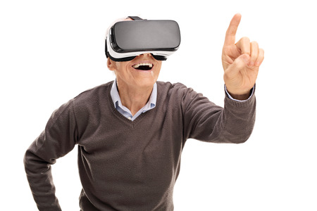 Senior gentleman experiencing virtual reality and reaching to touch something with his finger isolated on white background
