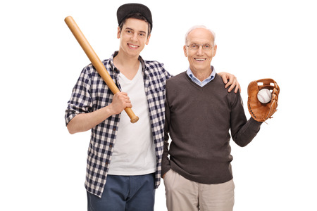 Father and son posing with a baseball bat and a ball isolated on white background