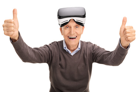 posing  agree: Senior giving thumbs up after using a VR headset isolated on white background Stock Photo