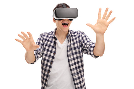 Excited man experiencing virtual reality via VR headset and touching something with his hands isolated on white background Reklamní fotografie - 53466975
