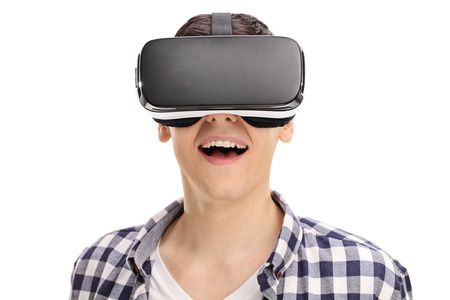 headset: Joyful man using a VR headset and experiencing virtual reality isolated on white background Stock Photo