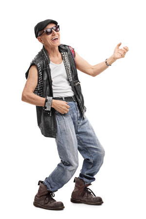 rocker: Full length portrait of a senior punk rocker playing air guitar isolated on white background Stock Photo