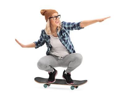 attitude girls: Cool skater girl riding a skateboard isolated on white background