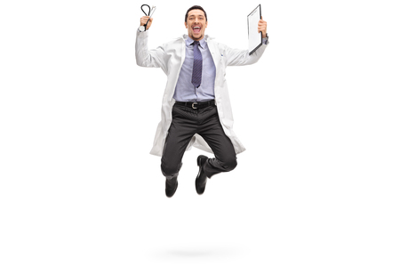 Full length portrait of a young doctor jumping out of joy isolated on white background Stock Photo