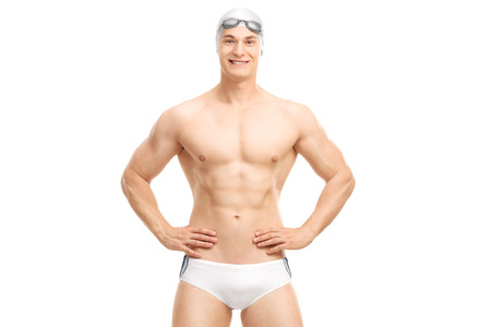 trunk: Young handsome swimmer posing in white swim trunks isolated on white background