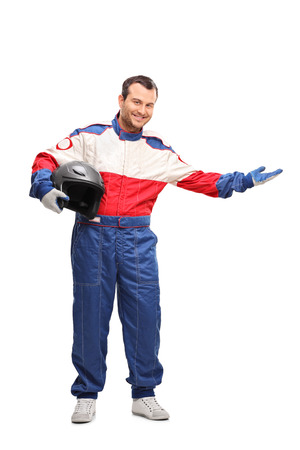 race car driver: Full length portrait of a young car racer holding a helmet and gesturing with his hand isolated on white background Stock Photo