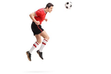 midair: Full length profile shot of a male football player heading a ball shot in mid-air isolated on white background