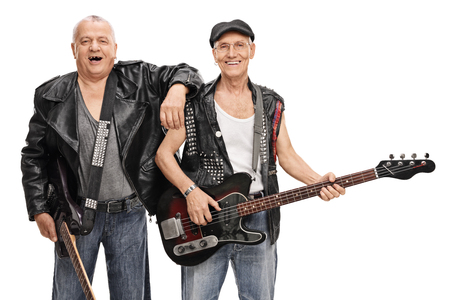 bass player: Senior punk guitarist and bass player posing together isolated on white background Stock Photo