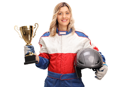 race car driver: Young female car racing champion holding a gold trophy and looking at the camera isolated on white background