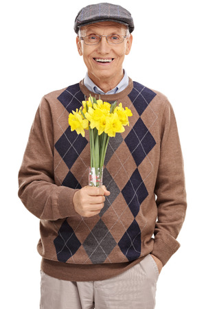 old man happy: Vertical shot of a romantic senior gentleman holding a bunch of flowers isolated on white background Stock Photo