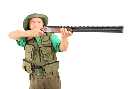 aiming: Studio shot of a mature hunter aiming with a rifle isolated on white background