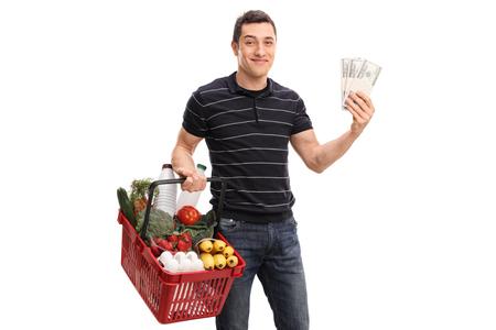 shopper: Economic man shopping and holding a few stacks of money isolated on white background