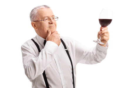 taster: Satisfied senior gentleman tasting some fine red wine isolated on white background
