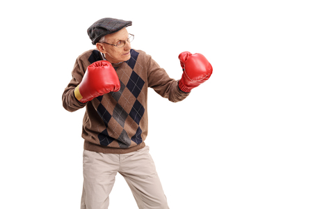 Studio shot of a senior man with red boxing gloves isolated on white background
