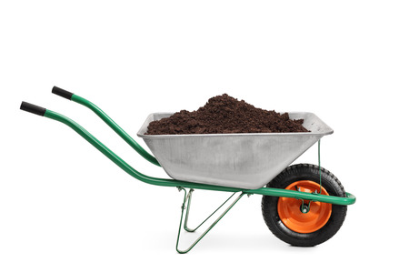 barrow: Studio shot of a wheelbarrow full of dirt isolated on white background Stock Photo