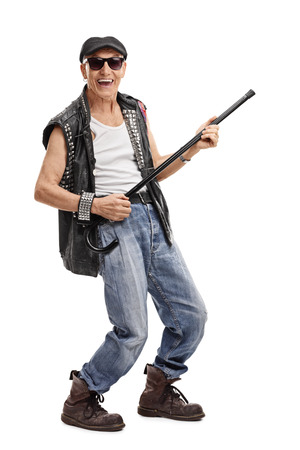 Full length portrait of a senior punk rocker pretending to play guitar on his cane isolated on white background Stock Photo