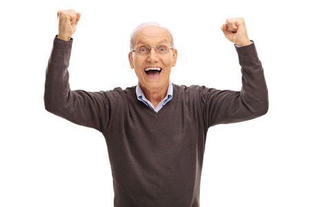 Studio shot of an excited pensioner gesturing happiness and looking at the camera isolated on white background Imagens