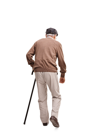 70s adult: Rear view vertical shot of an old man walking with a black cane isolated on white background