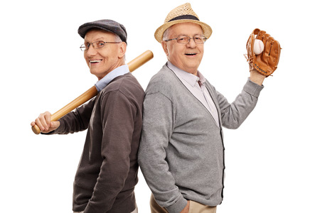 teammates: Studio shot of two old friends and baseball teammates posing together isolated on white background