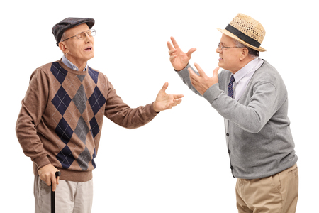 stubborn: Two stubborn mature men arguing with each other isolated on white background Stock Photo