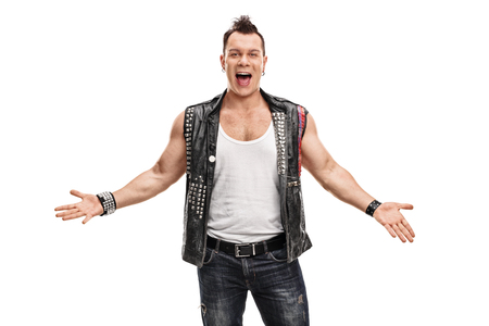 delinquent: Cheerful punk rocker in an old jacket with pins and badges gesturing with his hands isolated on white background