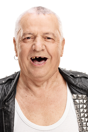 Vertical shot of a cheerful mature punk rocker with a few broken teeth isolated on white background