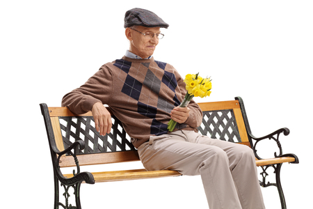 stood up: Stood up senior sitting on a wooden bench and waiting for his date isolated on white background Stock Photo