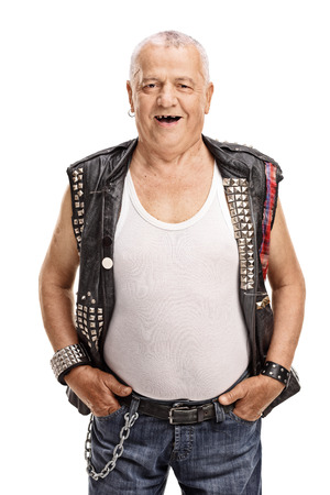 delinquent: Vertical shot of a cheerful mature punk rocker isolated on white background