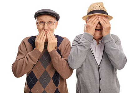 covering: Two cheerful senior gentlemen covering their eyes and mouth isolated on white background Stock Photo