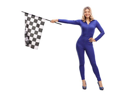 racer flag: Attractive racing woman waving a race flag and looking at the camera isolate on white background
