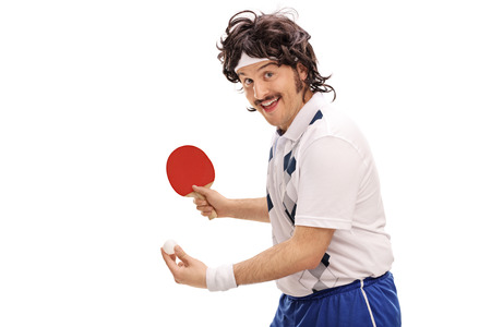 70s tennis: Young retro man playing table tennis and looking at the camera isolated on white background Stock Photo