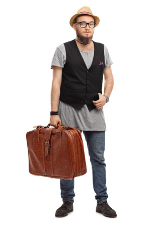 man style: Full length portrait of a young hipster holding a brown briefcase isolated on white background Stock Photo