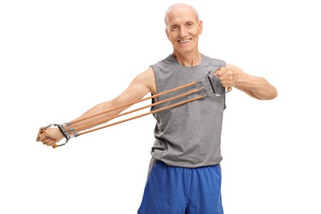 cords: Active senior exercising with a resistance band isolated on white background