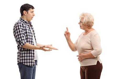 respetar: El estudio tiró de un hombre joven discutiendo con una mujer madura aislado en el fondo blanco Foto de archivo