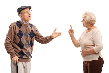 reluctant: Studio shot of an elderly couple arguing with each other isolated on white background
