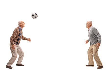 football play: Two seniors passing a football between themselves isolated on white background