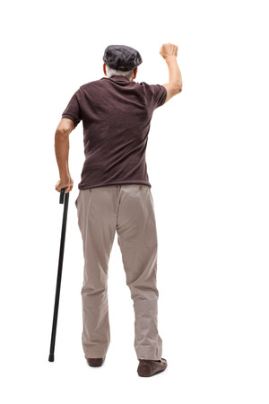 knocking: Full length rear view shot of a senior man knocking on a door isolated on white background