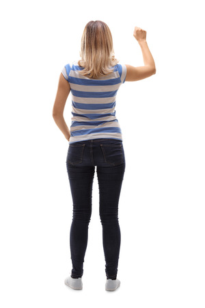 knocking: Full length rear view shot of a young woman knocking on a door isolated on white background