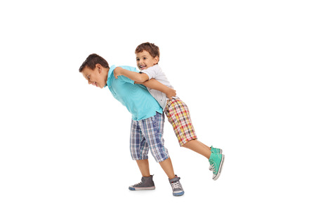 Two children playing with each other isolated on white background Stock Photo
