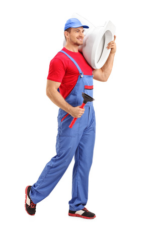 dungarees: Full length portrait of a cheerful male plumber carrying a toilet and a plunge isolated on white background