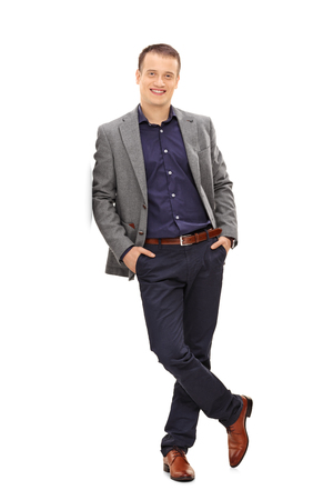 business casual: Full length portrait of a confident young man looking at the camera isolated on white background