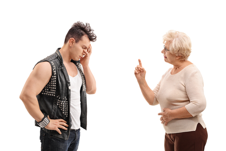 Senior woman arguing with a punker isolated on white background Stock Photo