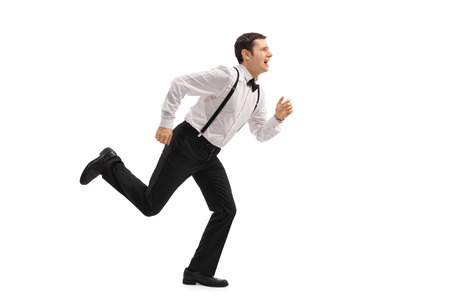 cowardice: Full length profile shot of a well-dressed man running away from something isolated on white background Stock Photo