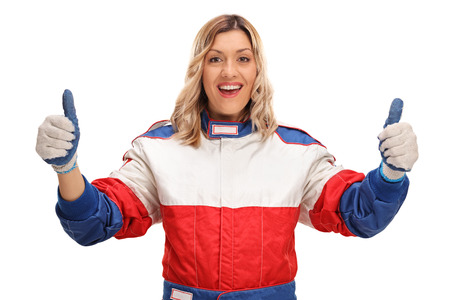 posing  agree: Cheerful female race driver making a thumbs up gesture with her hands isolated on white background