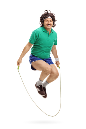 skipping rope: Vertical shot of a retro athlete exercising with a skipping rope isolated on white background