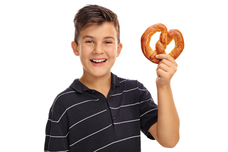 pretzel: Cheerful boy holding a pretzel isolated on white background