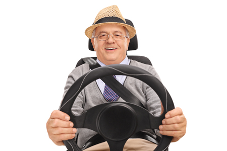 seatbelt: Smiling senior sitting on a car seat and driving isolated on white background