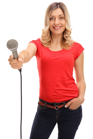 doing: Young woman holding a microphone and doing an interview isolated on white background