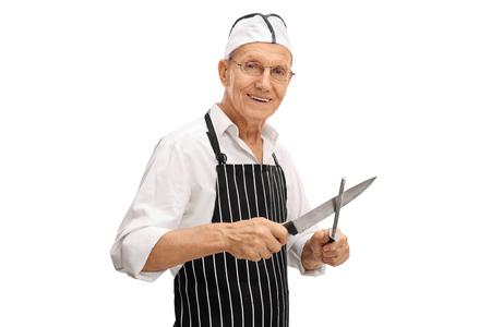 sharpening: Elderly butcher sharpening his knife isolated on white background Stock Photo