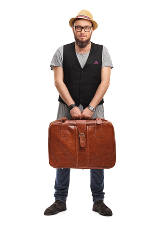 baggage: Young hipster holding a suitcase isolated on white background Stock Photo